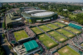 A view of the grounds during play overlooking the London skyline. The Championships 2017 at The All England Lawn Tennis Club, Wimbledon. Day 4 Thursday 06/07/2017. Credit AELTC/Joe Toth